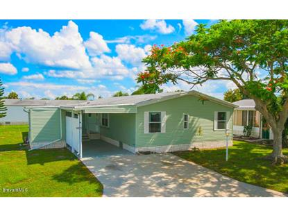 407 Eagle Drive Barefoot Bay, FL MLS# 700609