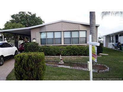927 Frangi Pani Drive Barefoot Bay, FL MLS# 728845