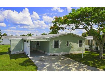 407 EAGLE DR  Barefoot Bay, FL MLS# 147551