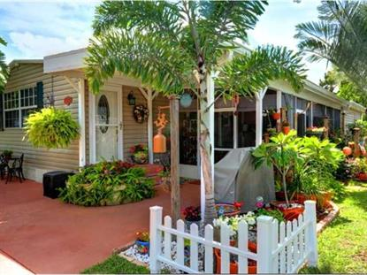 303 EGRET CIR  Barefoot Bay, FL MLS# 152010