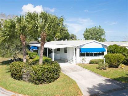 832 PERIWINKLE CIR  Barefoot Bay, FL MLS# 153996