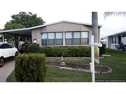 927 Frangi Pani Drive Barefoot Bay, FL MLS# 160936